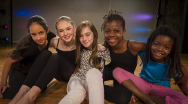 Lily Cummings (center) with Moving in the Spirit dancers Janan, Rosie, Zora and Beli.
