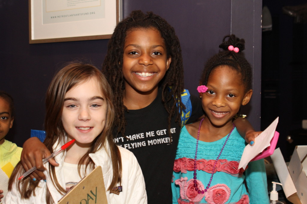 Lily (left) at the 2013 Holiday Store, with Moving in the Spirit student Zora and seven-year-old Hadiyah.