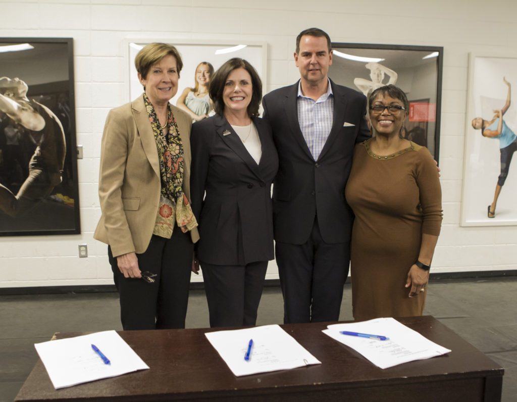 Elizabeth O'Neill (Interim CEO, MARTA), Jaimie Hardin (Board Chair, Moving in the Spirit), Dillon Baynes (Managing Partner, Columbia Ventures), and Genene Stewart (CFO, Moving in the Spirit) sign the lease on Wednesday, February 28, 2018